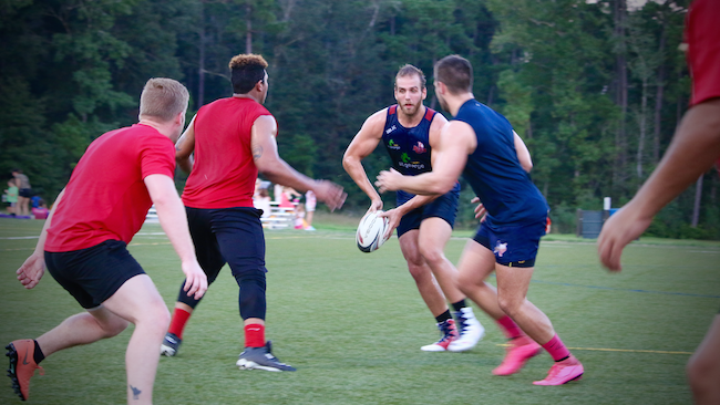 Colton Pederson running a practice drill with the Lone Star Rugby Club.