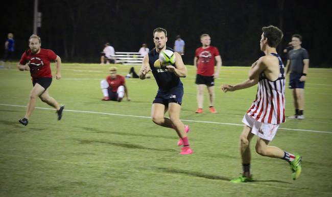 Conor Mills catching a pass during Lone Star Rugby Club's practice.