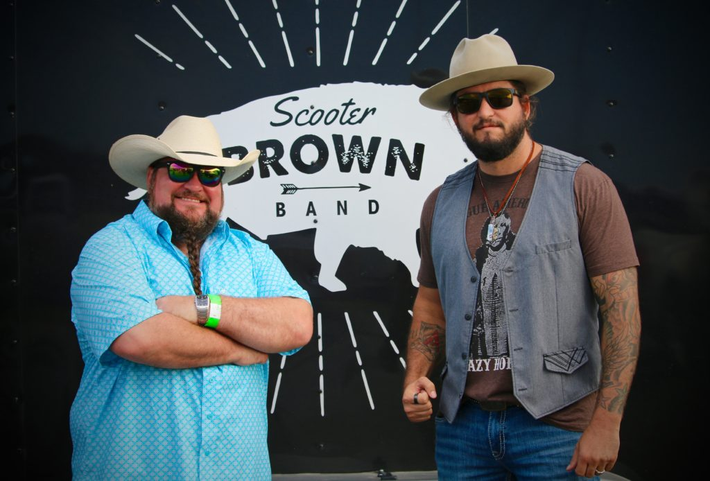 Sundance Head and Scooter Brown meet before their performances.