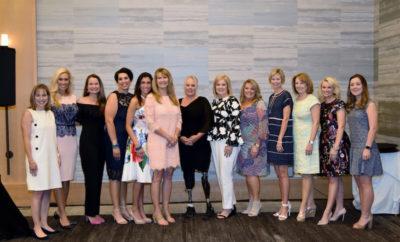 Dr. Debra Sukin, Missy Herndon, Stephanie Decker and Women Empowering Women Committee Members