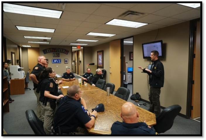 MCDAO Vehicular Crimes Chief Andrew James briefs the Task Force on Areas to Patrol.