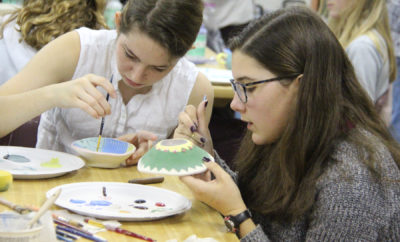 Katie Whalley and Maci Flanagan, John Cooper School ninth graders, glaze bowls for the Empty Bowls event to be held on February 24 on the campus of the PK-12 independent school.