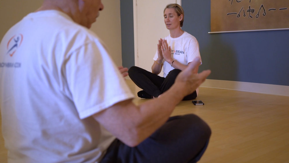 Owner and chief instructor Cherie Clark-Moore leads meditation exercises at every Body & Brain Conroe class. Along with stretching and breathing, many Body & Brain Conroe members credit the meditation with helping them relax and reduce stress.