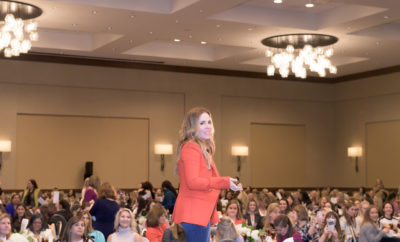 Photo 2 Cutline: Rachel Hollis speaks to 730 guests at Women Empowering Women (Photo Courtesy Derrick Bryant)