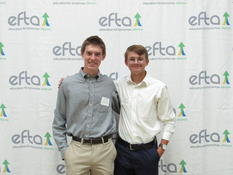 Caden Hanson, intern with Weygandt Law, and Wyatt Cade, intern with VLK Architects enjoy the luncheon