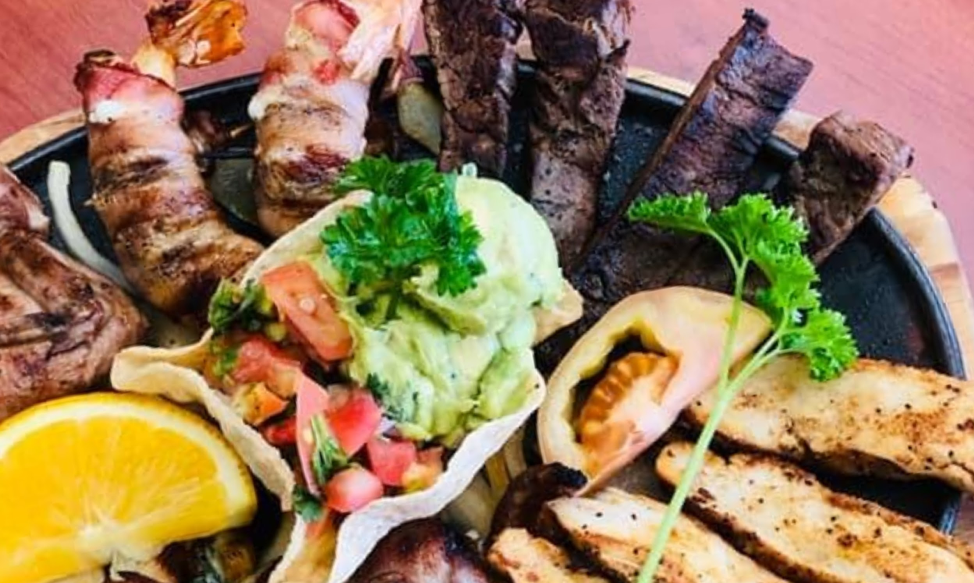El Bosque - Chicken & Beef Fajitas with Bacon Wrapped Shrimp special - Photo By El Bosque