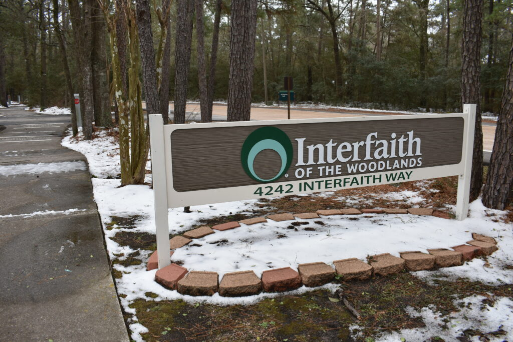 Interfaith of The Woodlands staff assist neighbors with food, grocery gift cards and gas cards at Drive Through Food Distribution this week.