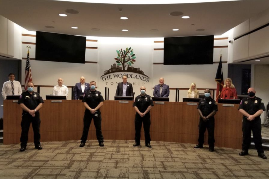 The Woodlands Township Board of Directors recognized The Woodlands Fire Department for their role in saving the life of ninth-grader Julieta Valdes after she experienced Sudden Cardiac Arrest, resulting in loss of pulse for 23 minutes. Front row, left to right: Lieutenant/EMT-Advanced Bill Holt, Firefighter/EMT-Basic Gary Rogers, Firefighter/EMT-Paramedic Travis Nicholson, Cadet Firefighter/EMT-Basic Reggie Jackson, and Battalion Chief/EMT-Advanced Mitch Hubbard. Back row, left to right: Director Jason J. Nelson, Treasurer John Anthony Brown, Vice Chairman Bruce Rieser, Chairman Gordy Bunch, Director Bob Milner, Director Dr. Ann K. Snyder, and Secretary Dr. Shelley Sekula-Gibbs.