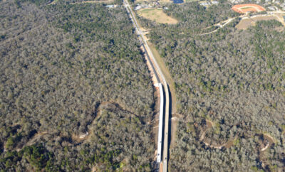Montgomery, Texas – A second bridge over Lake Creek is now open, providing four lanes of north and south access along Fish Creek Thoroughfare just south of Woodforest.