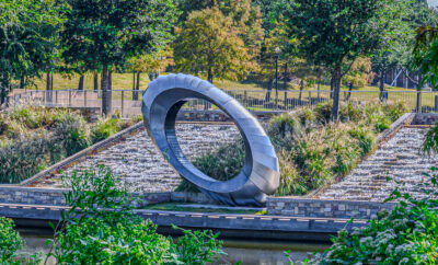 Visit the Mystical Senses Art Bench at the base of the waterfalls on The Woodlands Waterway