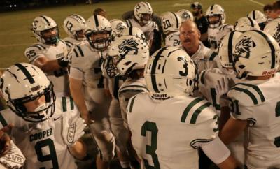 The John Cooper School Varsity Football huddle with Head Coach Erik DeHaven 2021